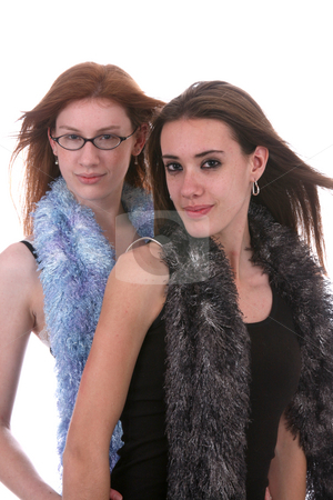 Two teens posing stock photo, Two beautiful teenage girls with windblown hair and fluffy scarfs by Sue and Shawn Roberts