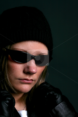 Woman in dark sunglasses stock photo, Attractive woman in dark sunglasses and black clothes. by Sue and Shawn Roberts
