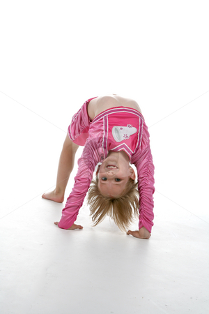 Cute girl in gymnastics bridge position stock photo, Cute girl in a gymnastics bridge position and a pink cheering outfit by Sue and Shawn Roberts