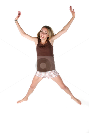 Happy teen jumping in the air stock photo, Happy teenage girl jumping in the air by Sue and Shawn Roberts