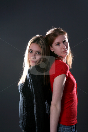 Two girls back to back stock photo, Two teenage sisters standing back to with highlights in their hair by Sue and Shawn Roberts