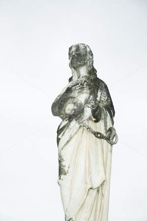Statue of Mary stock photo, A moss covered statue of Mary in a graveyard by Irene Scales