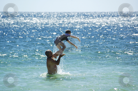 Summer Fun 1 stock photo, Father and Son having fun in the water at Port Rickaby, South Australia by Irene Scales