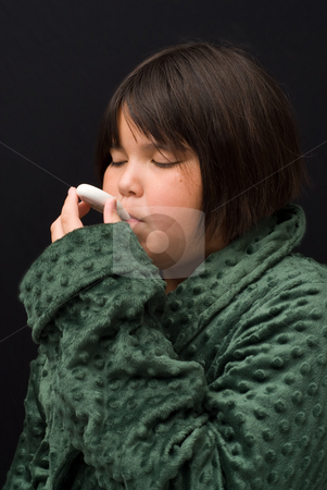 Sickness stock photo, A young girl taking her temperature with a thermometer by Richard Nelson