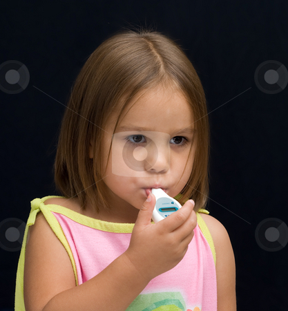 Sick Child stock photo, A sick kid with a thermometer in her mouth by Richard Nelson