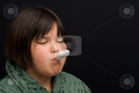 High Fever stock photo, A young girl trying to read a thermometer still in her mouth by Richard Nelson