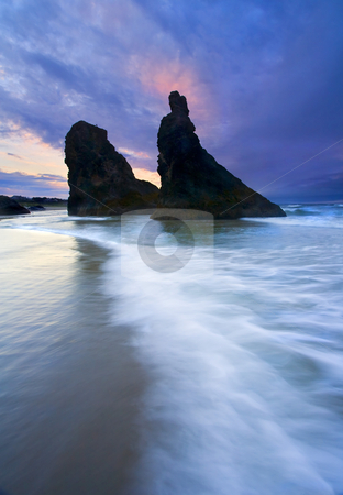 Heavenly Halo stock photo, A seastack along the Oregon coast near Bandon with just enough sunset color to resemble a Halo ringing the top of this jagged rock spire on the beach near Face Rock. by Mike Dawson