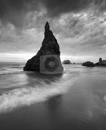 Stone Hat stock photo, A seastack on the ORegon coast near Bandon under a threatening sky looking very much like a stone wizards hat. by Mike Dawson