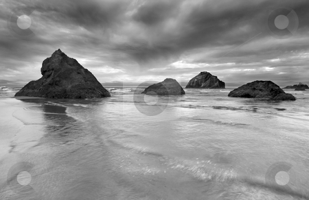 Clearing Storm stock photo, A storm clears over the rocks and seastacks near Face Rock along the Southern ORegon Coast by Mike Dawson