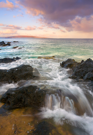 Sunrise Surge stock photo, Surging tides flow over lava rock along the South Coast of Maui as Kahaloowe glows with the light of dawn. by Mike Dawson
