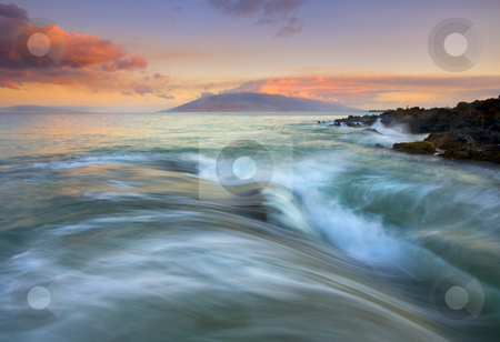 Folding the Sea stock photo, A bit of sunrise light over the West Maui Mountains and Lanai and a powerful sea ebbing and flowing over the rugged lava rock off the coast of Kihei. The way the ocean seemed to fold before me as I stood on rock had me in awe of the beauty of nature by Mike Dawson