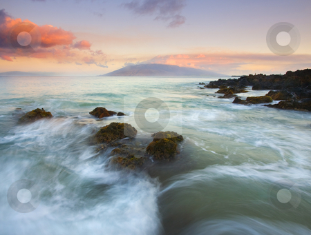 Undulations of the Sea stock photo, The undulations of the tides as it ebbs and flows over lava rock formations on the South Coast of Maui as the sunr rises, by Mike Dawson