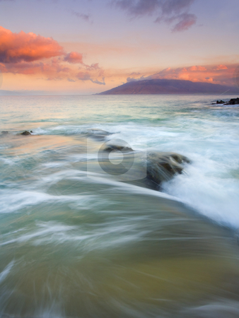 Sunrise Folds stock photo, Incoming tides swamping lava rock off the South Coast of Maui with the sun illuminating the mountains of West Maui. by Mike Dawson