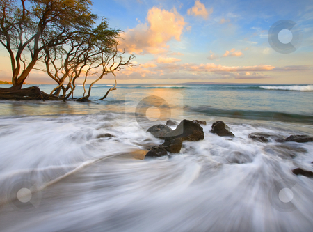 Sunset Tides stock photo, A color sunset as the tides roll in near Lahaina, Maui, Hawaii. by Mike Dawson