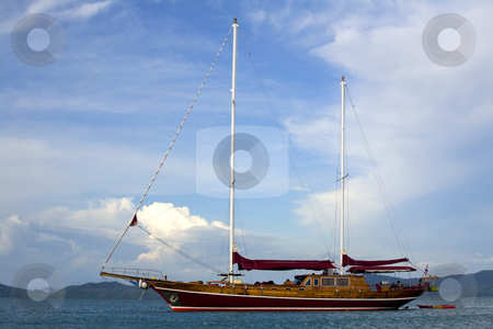 Yacht on the ocean stock photo, Beautiful wooden yacht on the ocean by Magdalena Ascough