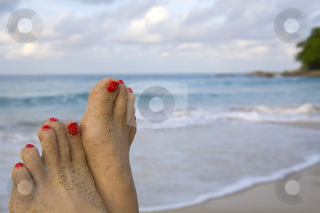 Woman's feet on a beach stock photo, Woman's feet with red nail polish on a beach by Magdalena Ascough