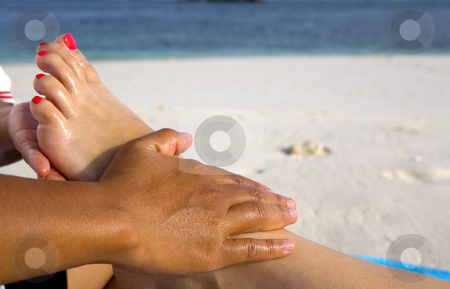 Foot massage on the beach stock photo, A foot massage on the beach by Magdalena Ascough