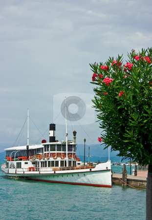 Ferry boat in Desenzano stock photo, Touristic ferry boat in Desenzano with blooming oleander on the foreground by Natalia Macheda