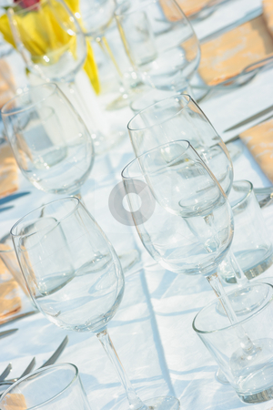 Table setting stock photo, Elegant table setting for many people outdoors by Natalia Macheda