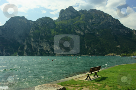 Lake Garda bench stock photo, Bench near lake Garda and mountain by Natalia Macheda