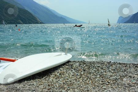 Surf board on Garda coast stock photo, Surf board dreaming on activity on Garda lake by Natalia Macheda