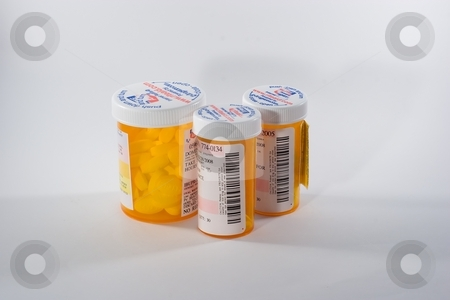 Pills stock photo, A pill is a small, round, solid pharmacological oral dosage form in use before the advent of tablets and capsules. by Mariusz Jurgielewicz