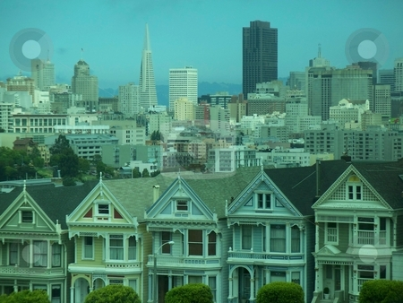 Famous View Of San Francisco stock photo, This is possibly the most famous view of San Francisco, byond the row of historic houses lies the heart of San Francisco . This is a high resolution photo (8 megapixels) and has alot of potential. by Andy C