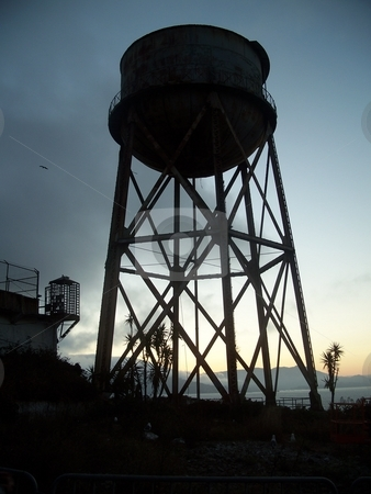 Water Tower At Sunset  stock photo, This is a water tower which is located on a historic island in america, the photo was taken at sunset with a 8 megapixel camera. by Andy C