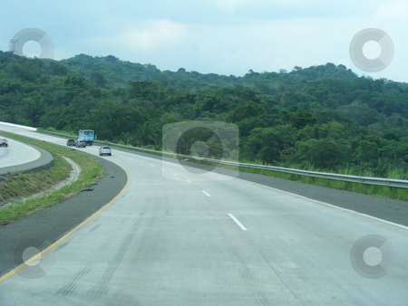 Tilting Road stock photo, A sectio of the Panamerican Highway running through the rainforest towards Costa Rica by Ray Roscoe