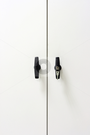White closet stock photo, White metallic closet detail black handles with keys vertical by EVANGELOS THOMAIDIS