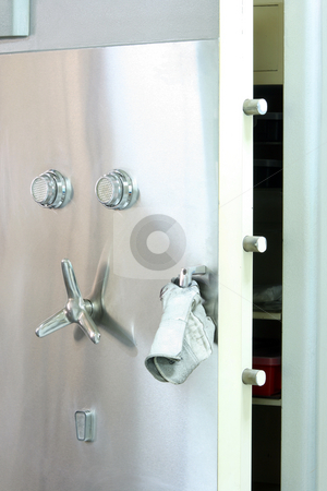 Open safe box stock photo, Steel safe box open by thief with a glove on handler by EVANGELOS THOMAIDIS