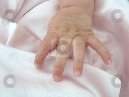 Baby hand stock photo, Baby girl's hand against pink blanket by Becky Miller