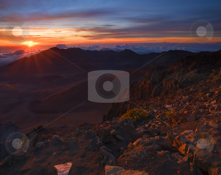 Above the Clouds stock photo, Haleakala on Maui at Sunrise. 80 degrees in Kihei at 3AM when we hit the road and 44 at 5AM at the 10,000 foot summit of Haleakala, a dormant volcano on the island of Maui. by Mike Dawson