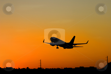 Leaving on a jet plane stock photo, A 737 takes off from Skyharbor airport in Phoenix as the sun rises. by Mike Dawson