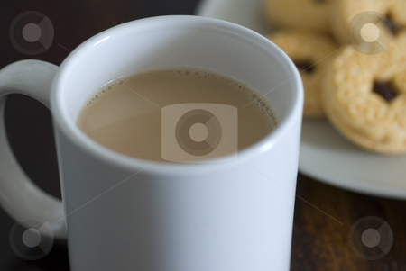 Tea and biscuits stock photo, A mug of white tea and plate jam biscuits by Stephen Gibson