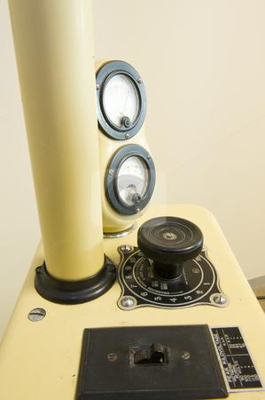 An ancient dental x-ray machine stock photo, A very old dental x-ray machine, still in use. by Nicolaas Traut