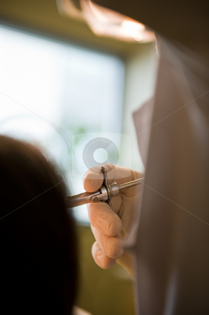 Dentist working stock photo, A mature dentist working on a lady patient, administering an injection. by Nicolaas Traut