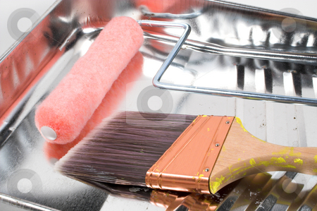 Painters Kit with paintbrush stock photo, Paint roller, brush and a metal paint roller pan. by Robert Byron