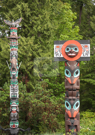 Historic Totem Poles stock photo, A pair of historic totem poles in Stanley Park, Vancouver Canada. by Steve Stedman