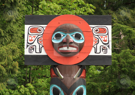 Historic Totem Pole stock photo, Carved face on a historic totem pole by ancient native people in Stanley Park, Vancouver, British Columbia, Canada. by Steve Stedman