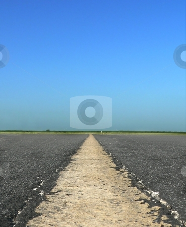 Centerline stock photo, Detail of centerline of aircraft taxiway or road by Perry Correll