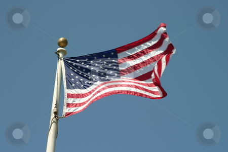 USA Flag stock photo, The flag of the United States Of America with the sky in the background by Henrik Lehnerer