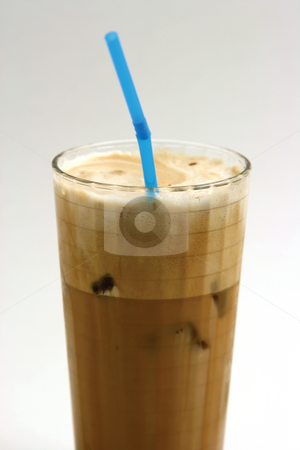 Ice coffee stock photo, A glass of nice greek way ice coffee frape with milk by EVANGELOS THOMAIDIS