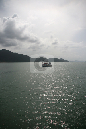 Fishing boat cloudy day stock photo, Fishing boat in a cloudy day koh chang island thailand by EVANGELOS THOMAIDIS