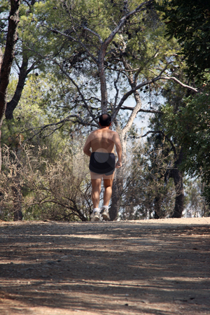 Jogging stock photo, Man is jogging in forest half nude by EVANGELOS THOMAIDIS