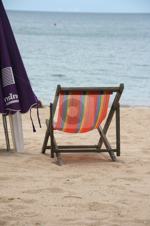 Sun chair stock photo, Sun chair by the shore by EVANGELOS THOMAIDIS