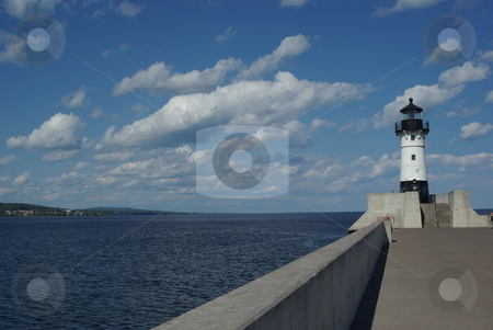 Lake Superior Lighthouse stock photo, This black and whilte Duluth, Minnesota lighthouse is one of two lighthouses marking the opening to the canal entry of the Duluth harbor on Lake Superior.  The old lighthouse is no longer in operation, but it is a popular tourist attraction in Duluth's Canal Park. by Dennis Thomsen