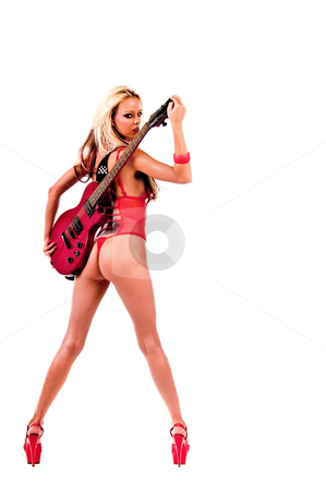 Rock N Roll chick with guitar stock photo, Rear facing view of a sexy young blonde lingerie model in a red one piece and red high heels with a red Les Paul style electric guitar by Robert Deal