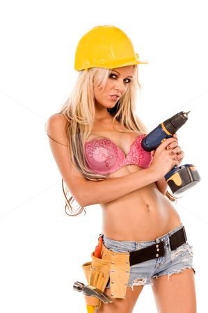 Female Construction Worker stock photo, High fashion glamour model in daisy duke shorts, tool belt, pink bra and yellow hard hat on a ladder with a screw gun by Robert Deal