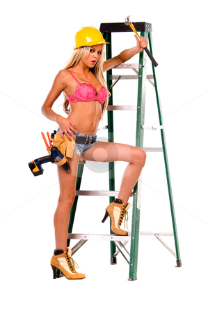 Sexy Construction Worker stock photo, High fashion glamour model in daisy duke shorts, tool belt, pink bra and yellow hard hat on a ladder by Robert Deal